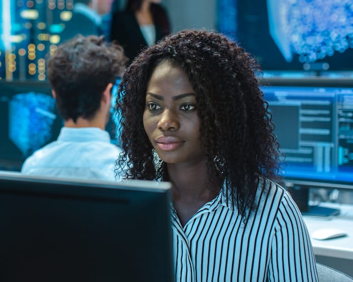Woman sitting in front of computer screen